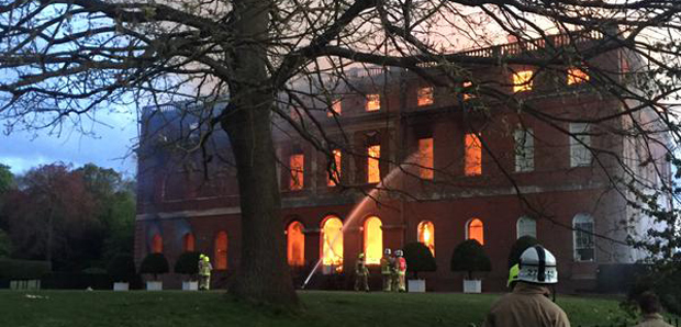 Clandon Park on fire - the flames reached the north side (Image: © Alex Greenwood)
